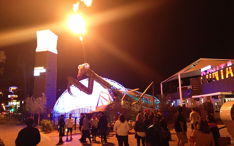 The Praying Mantis fire-breathing sculpture outside the container park in Old Downtown Las Vegas draws visitors and locals every night